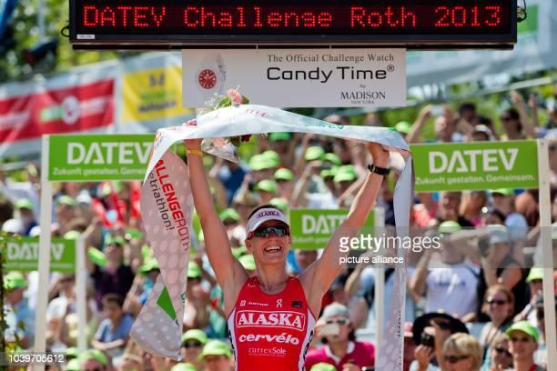 Swiss triathlete Caroline Steffen comes in first during the Datev Challenge Roth inSchwandGermany 14 July 2013 Triathlon participants mus swim 38...