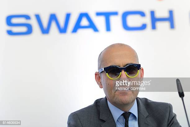 Swiss watchmaker Swatch Group CFO Thierry Kenel looks on as he wears Swatch Sunglasses during a press conference to present annual results of the...