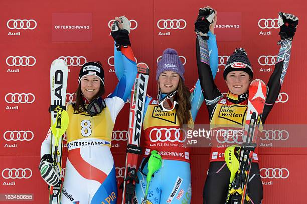 Swiss Wendy Holdener Slovenian Tina Maze and US Mikaela Shiffrin pose during the winner ceremony of the FIS World Cup Women's Slalom competition in...