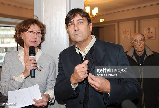 Swiss writer Alain Claude Sulzer poses next to head of the jury Anne Wiazemsky after receiving the 'Prix Medicis etranger' for his book 'Un garcon...