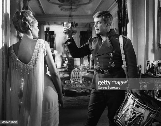 SwissAmerican actress Ursula Andress and American actor George Peppard on the set of The Blue Max based on the novel by Jack Hunter and directed by...