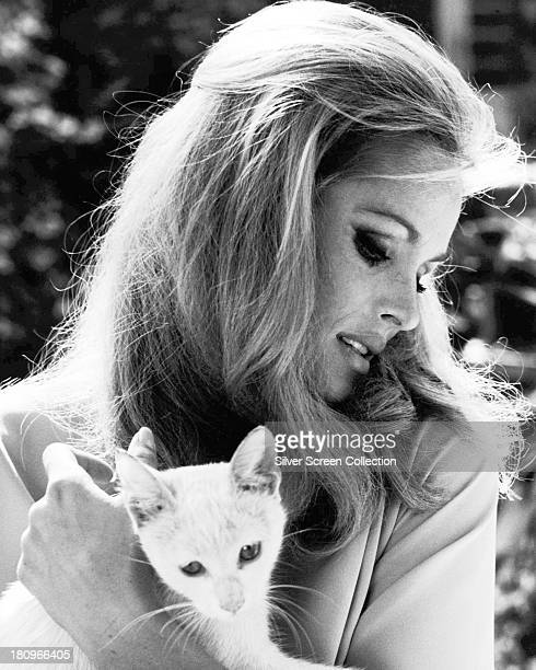 SwissAmerican actress Ursula Andress holding a cat circa 1968