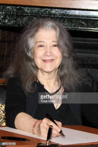 Swiss-Argentinian pianist Martha Argerich signs the golden book at Hamburg City Hall on June 27, 2018 in Hamburg, Germany.