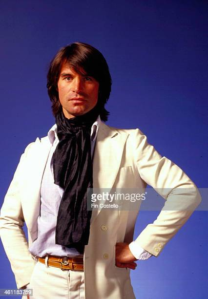 Swissborn actor Oliver Tobias wearing a white suit in a posed portrait 1978