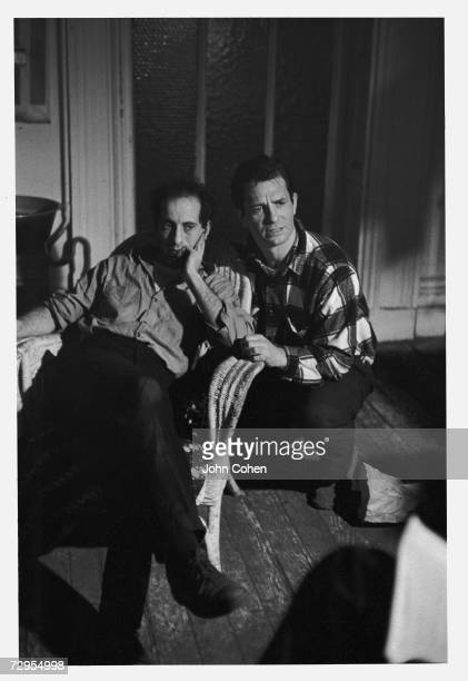 Swissborn American photographer and film director Robert Frank sits with head on hand and American Beat poet Jack Kerouac kneels next to him as they...