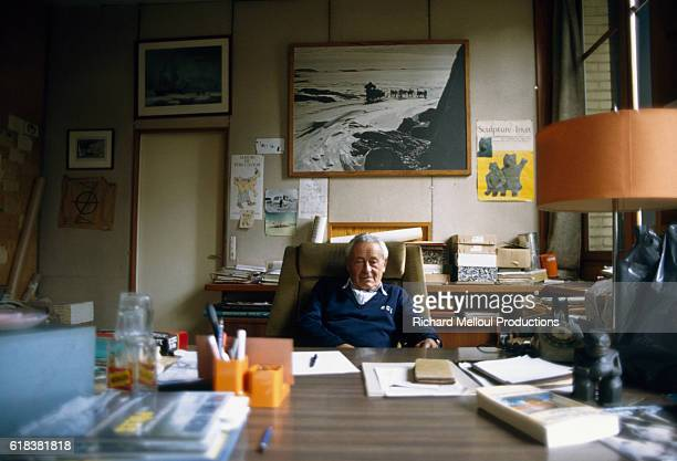 Swiss-born French polar explorer Paul-Emile Victor sits behind his desk at home.