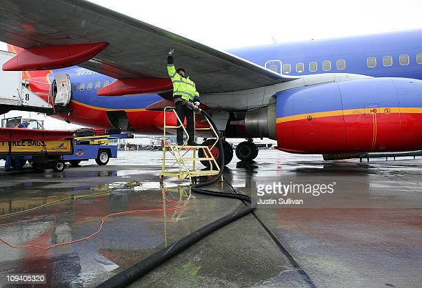 Swissport employee Miroslaw Kaczorowski prepares to refuel a Southwest Airlines plane at the Oakland International Airport on February 24 2011 in...