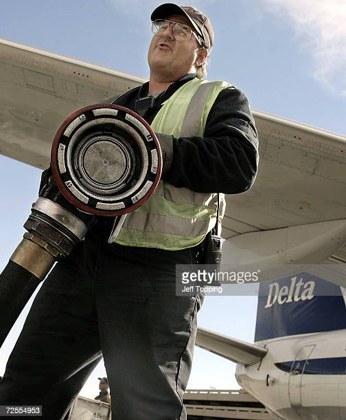 Swissport Fueling employee Daniel Berg removes a fuel hose after refueling this Delta AirLines jet at Phoenix Sky Harbor International Airport...