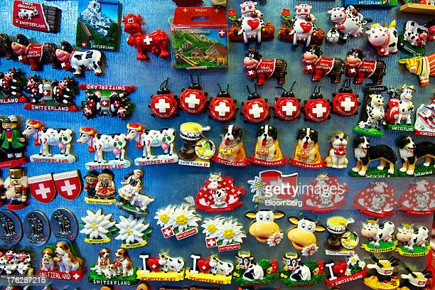 Swissthemed novelty magnets are displayed for sale inside a souvenir store in Lucerne Switzerland on Saturday Aug 10 2013 The Swiss National Bank...