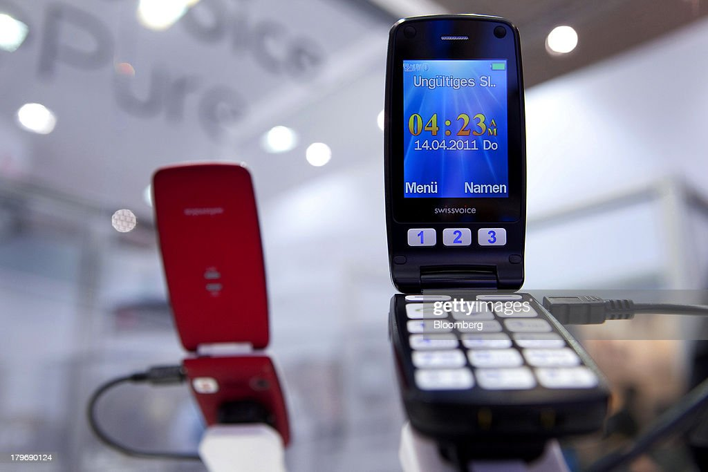 Swissvoice SA MP40 mobile phones are displayed at the IFA consumer electronics show in Berlin, Germany, on Friday, Sept. 6, 2013. Global smartphone revenue will rise 22 percent in 2013, or nearly half the pace of an expected 41 percent gain in shipments, amid falling prices, according to UBS. Photographer: Krisztian Bocsi/Bloomberg via Getty Images