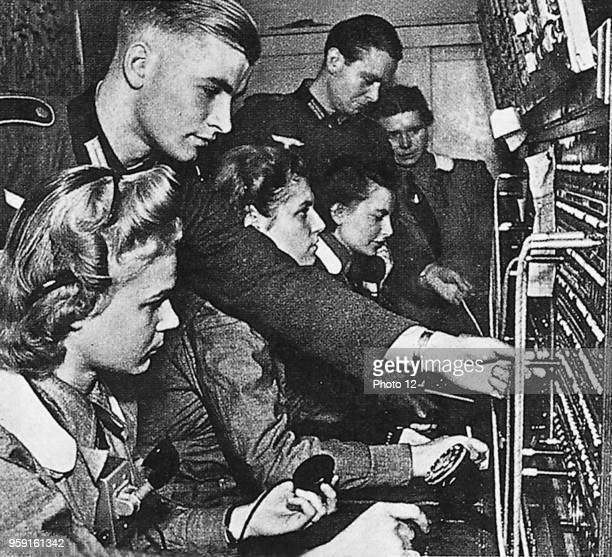 Switch board operators doing their service at the telephone exchange of the Wehrmacht in Paris are being trained by experts