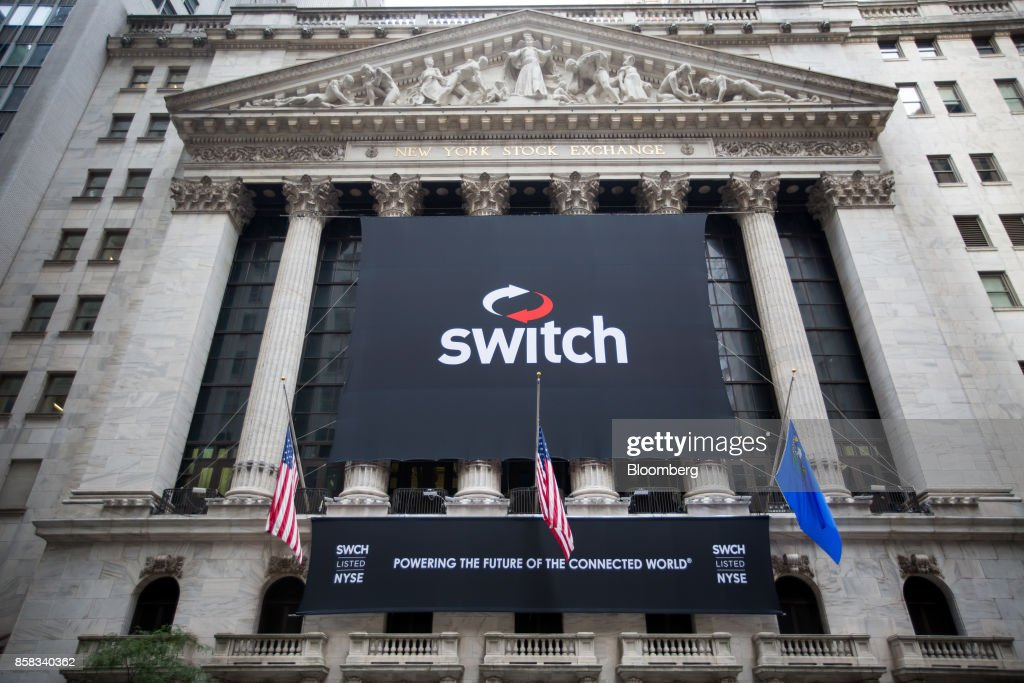 Switch Inc. signage is displayed outside of the New York Stock Exchange (NYSE) during the company's initial public offering (IPO) in New York, U.S., on Friday, Oct. 6, 2017. Switchjumped by almost half in its trading debut after raising $531 million in an initial public offering, the third-biggest technology IPO this year in the U.S.. Photographer: Michael Nagle/Bloomberg via Getty Images