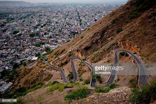A switchback road and Jaipur city seen from Tiger Fort, Rajasthan, India