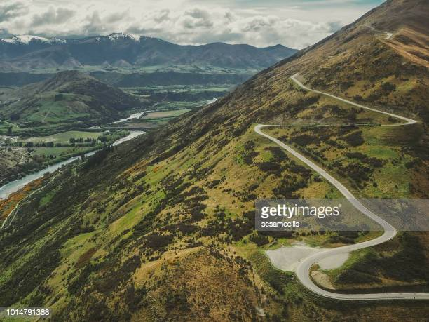 switchback road, remarkables mountain range, queenstown, south island, new zealand - hairpin curve stock photos and pictures