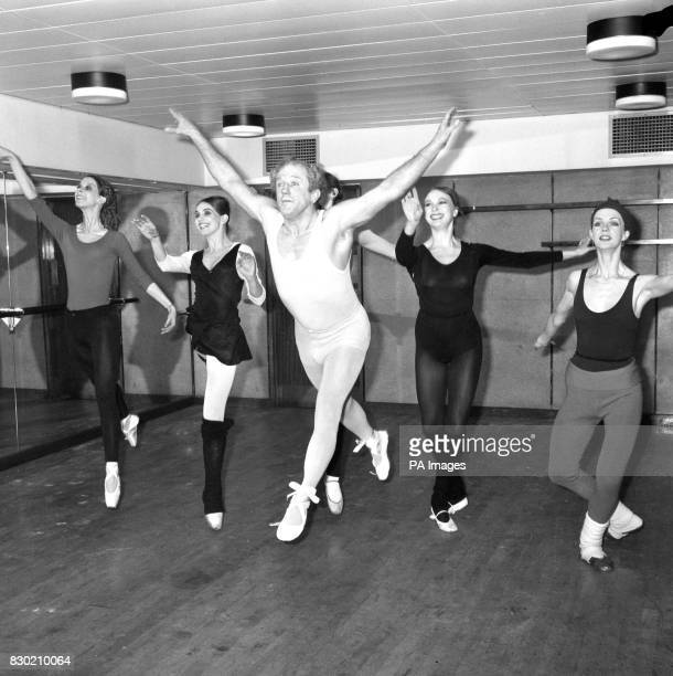 Switching from the wrestling ring to the stage Jackie Pallo rehearses at the Festival Hall in London with ballerinas of the Festival ballet company...