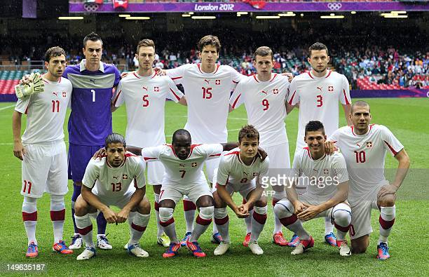 Switwerland's football team poses before the London 2012 Olympic Games men's football match between Mexico and Switzerland at the Millennium Stadium...