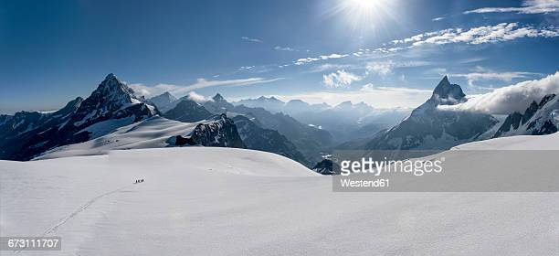 switzerlalnd, mountaineers heading to matterhorn and wandfluehorn - panoramic stock pictures, royalty-free photos & images
