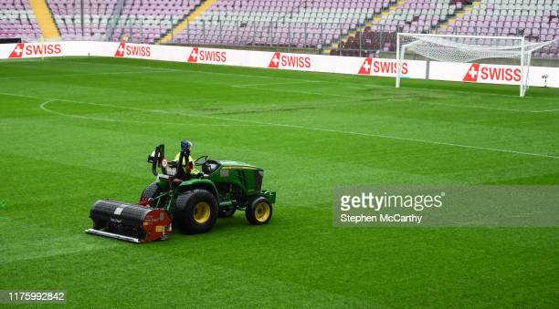 GENEVA Switzerland 15 October 2019 A member of the Stade de Genève grounds staff prepares the pitch prior to the UEFA EURO 2020 Qualifier match...