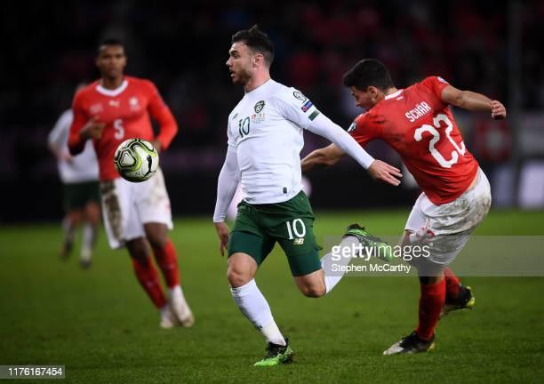 Switzerland - 15 October 2019; Scott Hogan of Republic of Ireland in action against Fabian Schär of Switzerland during the UEFA EURO 2020 Qualifier...