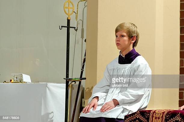 Switzerland Aargau Zurzach altar boy during the mass in the church Saint Afra