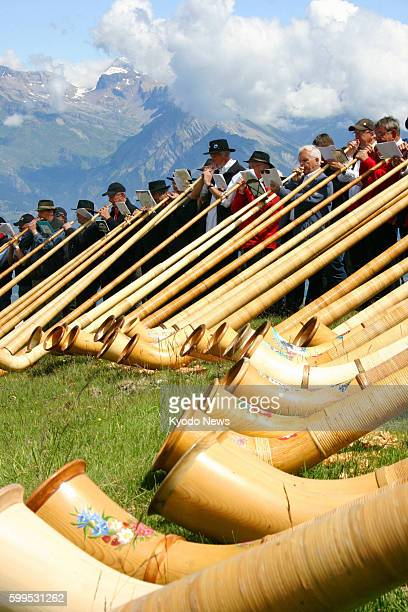 NENDAZ Switzerland Alphorn players perform tunes at a concert in Nendaz southern Switzerland on July 22 2012