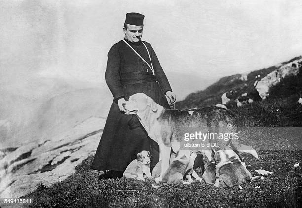 Switzerland Alps canton of Valais monk with Saint Bernard dog of the convent shedog with puppies 1924 Photographer Sennecke Published by 'Berliner...