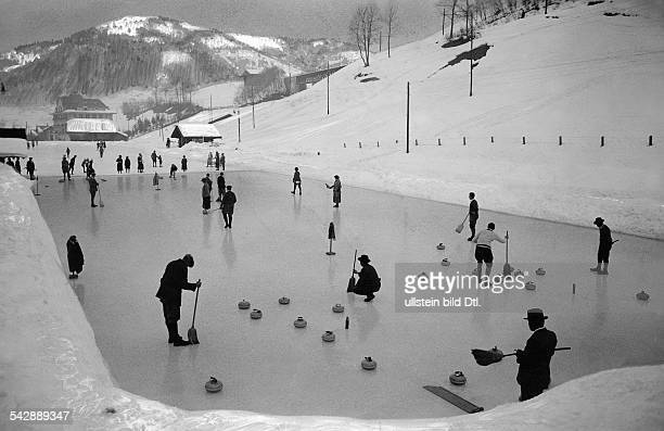 Switzerland Alps men playing curling in St Gstaad date unknown probably 1929 published in photo by J Naegeli