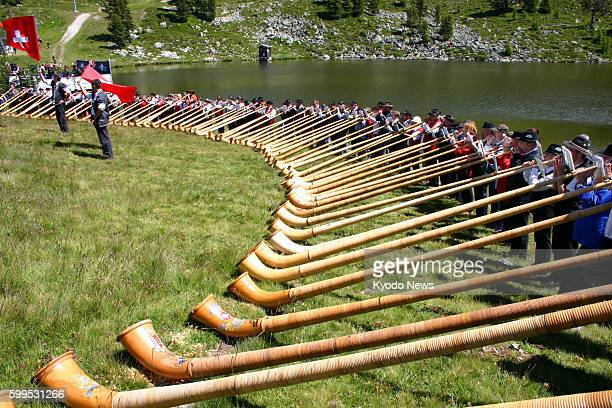 NENDAZ Switzerland An alphorn concert is held at a lakeside in Nendaz southern Switzerland on July 22 2012