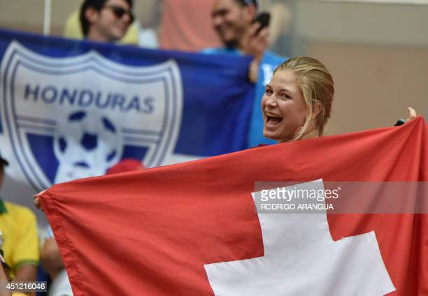 Switzerland and Honduras fans cheer before the Group E football match between Honduras and Switzerland at the Amazonia Arena in Manaus during the...