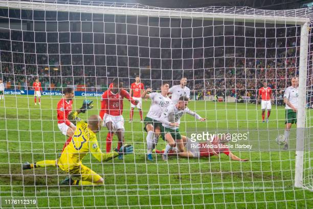 Switzerland and Ireland players battle for the ball after a penalty save during the UEFA Euro 2020 qualifier between Switzerland and Republic of...