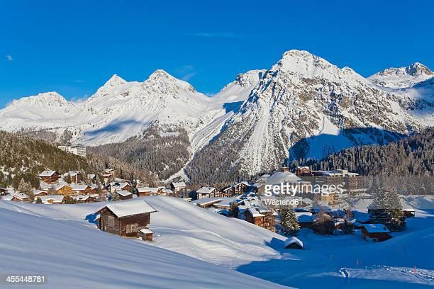 switzerland, arosa, view of chalet houses in snow - アロサ ストックフォトと画像
