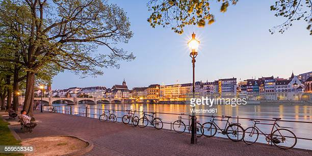 switzerland, basel, city view and rhine at dusk - basel switzerland stock pictures, royalty-free photos & images