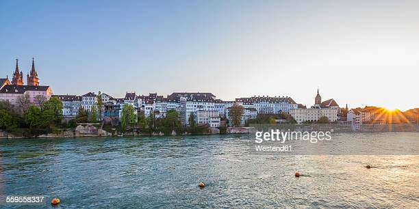 Switzerland, Basel, city view from the bank of the Rhine at dusk