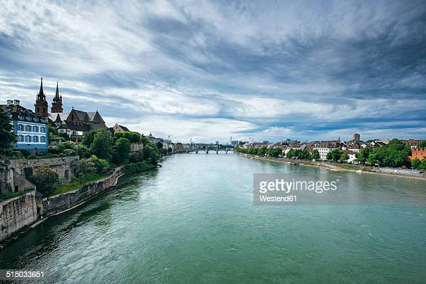 switzerland, basel, cityscape with river rhine and minster - minster stock photos and pictures