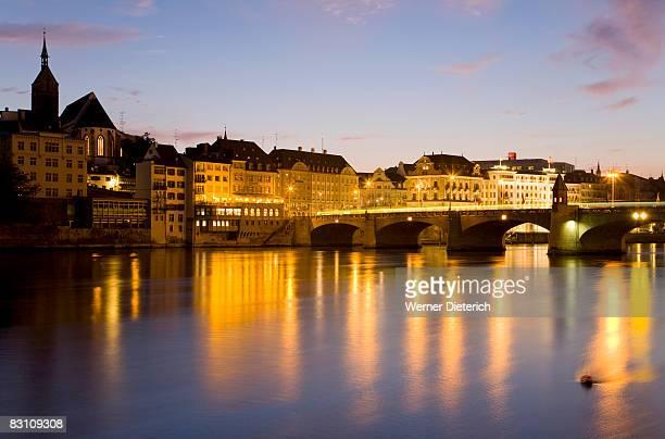 Switzerland, Basel, Rhine river, cityscape at dusk