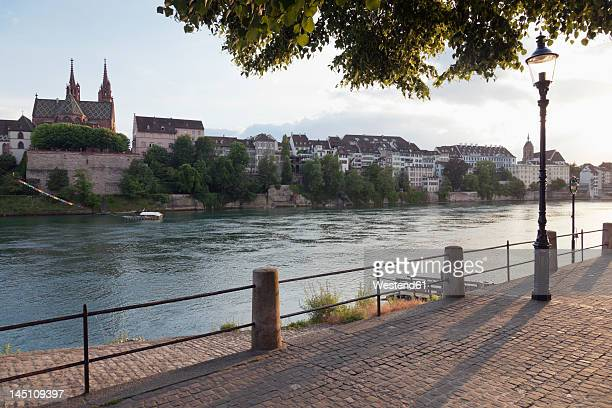 switzerland, basel, view of basel munster across rhine river - basel port stock photos and pictures