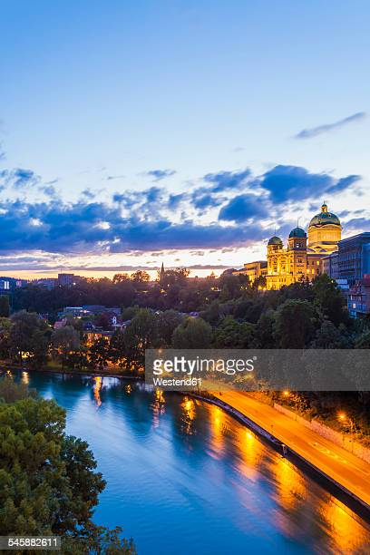 Switzerland, Bern, cityscape with Federal Palace and River Aare in the evening