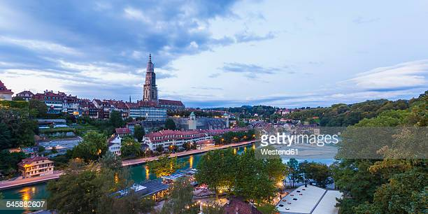 Switzerland, Bern, cityscape with minster and River Aare in the evening