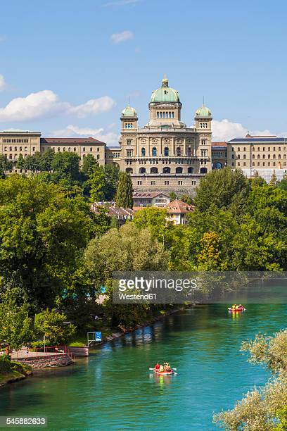 switzerland, bern, federal palace and river aare - ベルン ストックフォトと画像