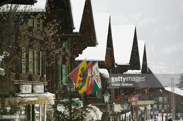 switzerland, bern, gstaad, saanenstrasse, street scene, winter - gstaad stock pictures, royalty-free photos & images
