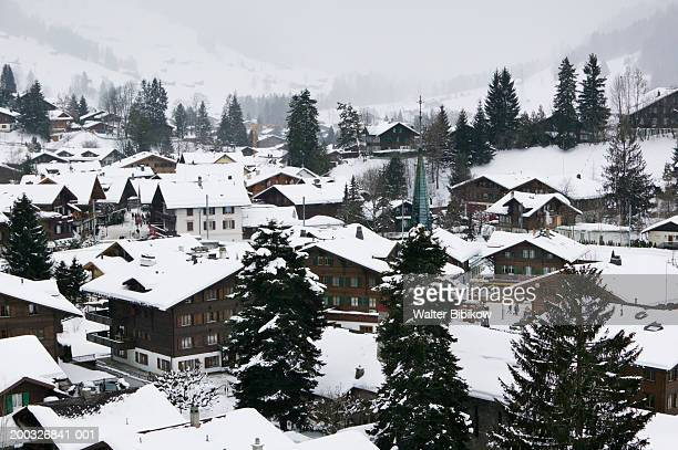 switzerland, bern, gstaad, town view, winter - gstaad stock pictures, royalty-free photos & images