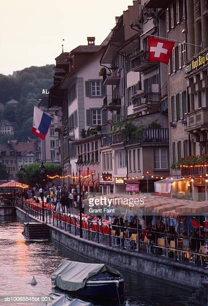 Switzerland, Berne, tourists at cafes