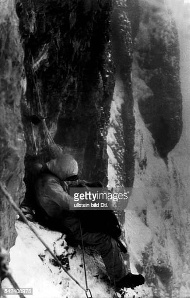 Switzerland Bernese Alps EigerFirst ascent of Eiger north face 2124July 1938 Preparations for bivouac in the mountain face July 1938