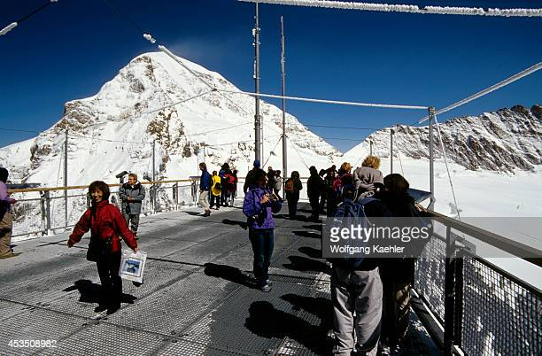 Switzerland Bernese Oberland Jungfraujoch Sphinx Viewpoint People Monch Mountain In Background