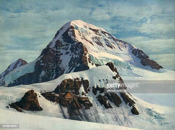 Switzerland BernKanton Jungfraujoch is a col or saddle between the Moench and the Jungfrau in the Bernese Alps on the boundary between the cantons of...