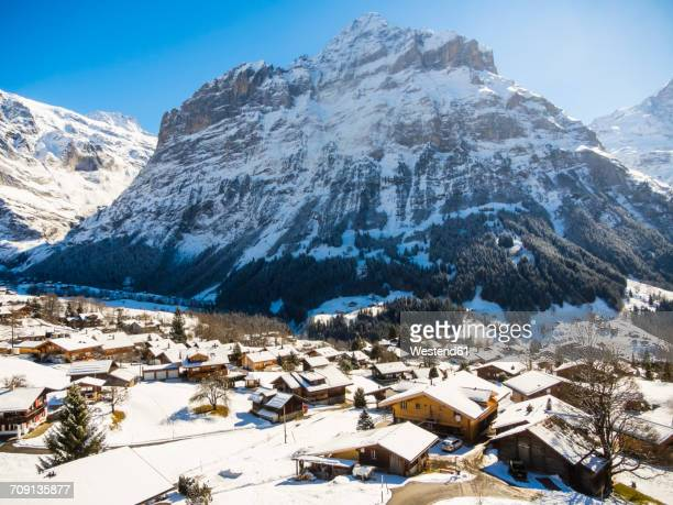 Switzerland, Canton of Bern, Grindelwald, townscape in winter at sunrise with Mittelhorn
