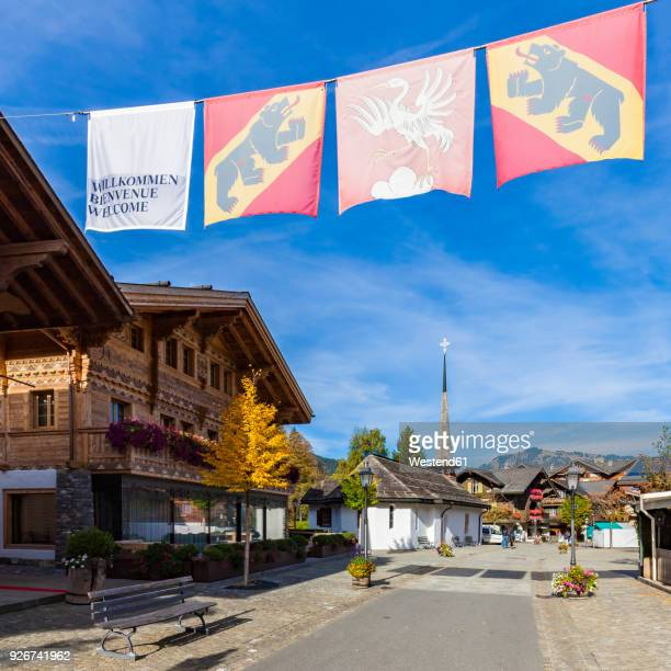 switzerland, canton of bern, gstaad, pedestrian area and chapel - グスタード ストックフォトと画像