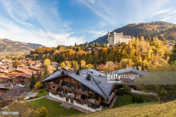 switzerland, canton of bern, gstaad, townscape with gstaad palace hotel - gstaad stock pictures, royalty-free photos & images