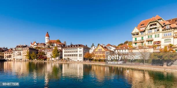 switzerland, canton of bern, thun, river aare, old town with parish church and aarequai - altstadt stock-fotos und bilder