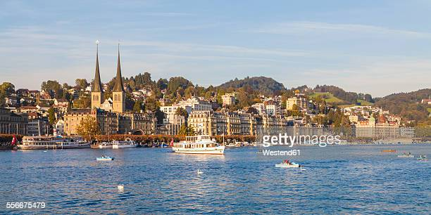 Switzerland, Canton of Lucerne, Lucerne, Lake Lucern with boats and excursion ships, court church in the background